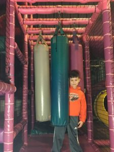 boy with punching bags